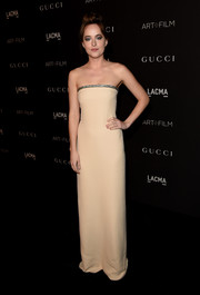 Dakota Johnson's nude Gucci strapless gown at the LACMA Art + Film Gala looked oh-so-elegant in its simplicity.