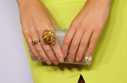 Laura Dundovic carried a little extra bling - check out her silver rhinestone-encrusted clutch!