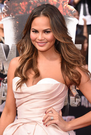 Chrissy Teigen looked divine with her center-parted feathered waves during the MTV Movie Awards.