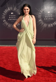 Singer Jessie J went for the goddess look in a pistachio green vintage Halston gown with a plunging neckline