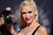 Gwen Stefani's berry lipstick matched wonderfully with her bright look.
