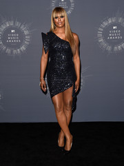 Orange is the New Black star Laverne Cox glammed up the 2014 VMAs in a black Marc Bouwer sequin, one-shoulder mini dress and black heels.