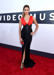 Nina Dobrev looked stunning in one of our favorite gowns of the night—a black and red Zuhair Murad creation with a plunging neckline.