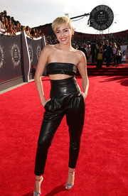 At the 2014 VMAs, Miley Cyrus was more covered up than we're used to seeing her in an Alexandre Vauthier black leather bandeau bralette and harem pant.