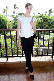 Evan Rachel Wood kept it simple in a fitted white blouse by Roland Mouret teamed with black skinny pants during the Maui Film Festival opening night reception.