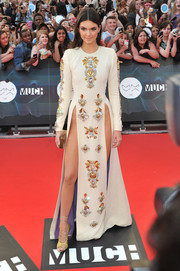 Kendall Jenner put way too much skin on display at the MuchMusic Video Awards in an embellished white Fausto Puglisi dress with double side slits that went up almost to her waist.
