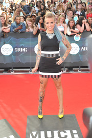 Phoebe Dykstra showed off her tattooed pins in a matching mini skirt.