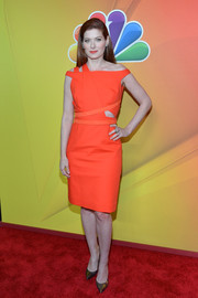 Debra Messing went for an ultra-modern vibe in an asymmetrical orange cutout dress by Kaufmanfranco during the NBC Upfront Presentation.