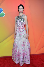 Opting for simple styling, Krysten Ritter accessorized with a Lauren Merkin Lucca clutch.