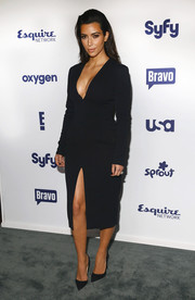 Kim Kardashian exposed some skin in an LBD with a plunging neckline and a thigh-high slit during the NBCUniversal Cable Entertainment Upfronts.