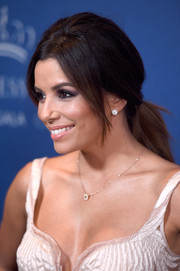 Eva Longoria styled her tresses in a retro-chic ponytail for the Princess Grace Awards Gala.