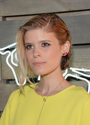 Kate Mara sported an edgy-glam braided updo at the Coach Summer Party.