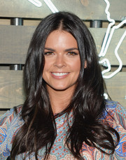 Katie Lee wore her hair with a center part and beachy waves during the Coach Summer Party.