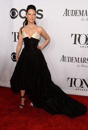 Lucy Liu completed her gorgeous red carpet look with black ankle-cuff sandals by Nicholas Kirkwood.