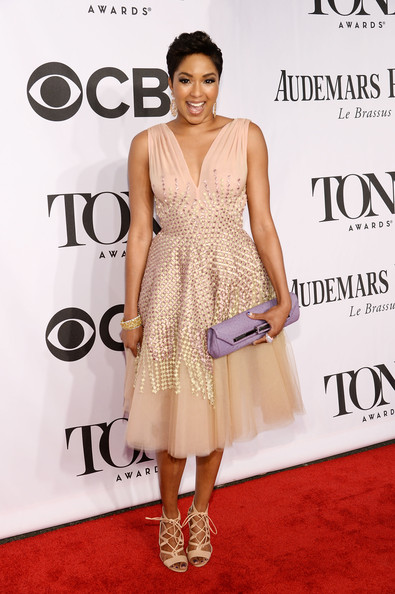 Alicia Quarles paired her lovely frock with nude lace-up gladiator heels.