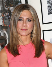 Jennifer Aniston flaunted a super-sleek center-parted 'do at the screening of 'Cake.'