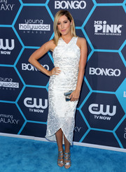 Ashley Tisdale completed her shimmery look with a metallic silver clutch.