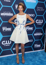Alysia Reiner finished off her sweet look with a pair of nude ankle-wrap sandals.