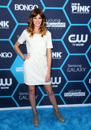 Rachel Melvin styled her dress with a pair of taupe cutout ankle boots.