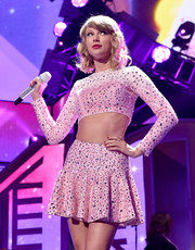 Taylor Swift sparkled on stage in a custom-made pink crop top at the iHeartRadio Music Festival.