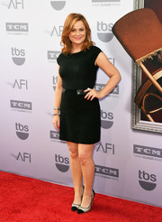 Amy Poehler teamed her mini dress with a pair of black-and-white mesh cap-toe pumps.