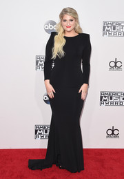 Meghan Trainor kept it minimal in a bold-shoulder black gown by Michael Costello at the American Music Awards.