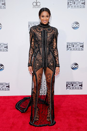 Ciara brought a heavy dose of sexiness to the American Music Awards red carpet in a sheer, beaded black gown by Reem Acra.