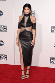 Kylie Jenner complemented her sizzling-hot dress with the celeb-favorite Tamara Mellon Frontline, in black.