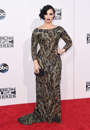 Demi Lovato flaunted her shapely figure in a body-con camo-patterned mesh gown by Lorena Sarbu at the American Music Awards.