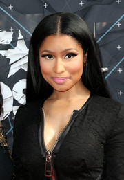 Nicki Minaj accentuated her eyes with fluttery false lashes.