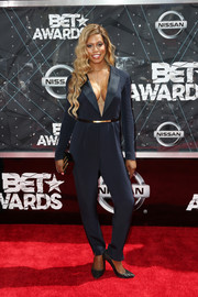 Laverne Cox showed major cleavage at the BET Awards in a plunging navy jumpsuit by Dmitry Sholokhov.