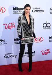Kendall Jenner injected an extra dose of fierceness with a pair of black suede over-the-knee boots by Balmain.