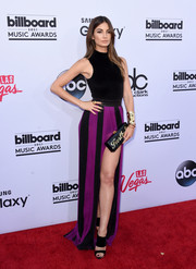 Lily Aldridge paired her dress with strappy black mules by Giuseppe Zanotti.