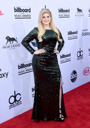 Meghan Trainor looked like an Old Hollywood star in a fully sequined dark-green gown by Badgley Mischka during the Billboard Music Awards.