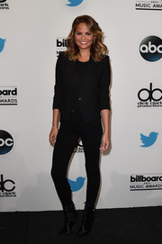 Chrissy Teigen was casual and edgy in a black blazer and skintight jeans at the Billboard Music Awards finalists press conference.