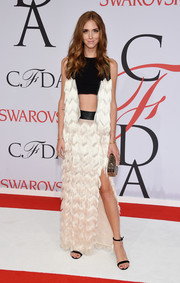 Chiara Ferragni was punk-glam at the CFDA Fashion Awards in a black-and-white Rebecca Minkoff gown featuring a midriff-baring top cascading down to chevron-patterned fringes.