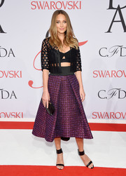 Hannah Davis layered a sheer black cropped jacket over a bra top, both by Milly, for her CFDA Fashion Awards look.