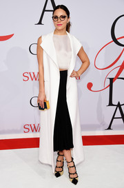 Katharine McPhee completed her look with a black and gold box clutch by Lee Savage.