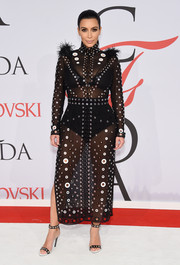 Kim Kardashian looked quite the glamazon ready for a sartorial battle in her fully grommeted, sheer Proenza Schouler LBD at the CFDA Fashion Awards.