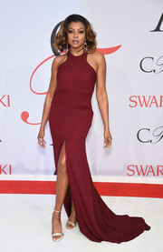Taraji P. Henson sashayed down the CFDA Fashion Awards white carpet in a wine-colored racer-neckline gown by Vera Wang.