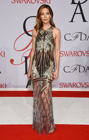 Michelle Monaghan brought a dose of '20s glamour to the CFDA Fashion Awards with this Art Deco-inspired gold gown by Monique Lhuillier.