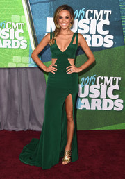 Jana Kramer was trendy-glam in an emerald-green cutout gown by Lorena Sarbu during the CMT Music Awards.