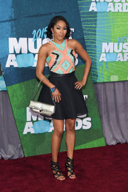 Alicia Quarles attended the CMT Music Awards wearing a fun and flirty racer-neckline mini dress with a geometric-patterned bodice.
