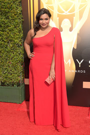 Mindy Kaling looked like royalty in this caped red one-shoulder gown by Salvador Perez during the Creative Arts Emmy Awards.