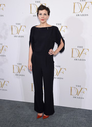 Maggie Gyllenhaal chose a simple yet sophisticated black boatneck blouse with split sleeves for the DVF Awards.