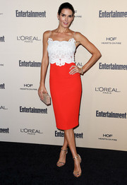 Angie Harmon looked sophisticated at the Entertainment Weekly pre-Emmy party in a spaghetti-strap dress with an embroidered white bodice and a red skirt.