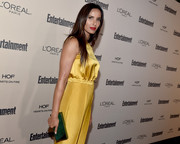 Padma Lakshmi went for a color-block look with this emerald-green box clutch and yellow jumpsuit combo at the Entertainment Weekly pre-Emmy party.