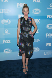 January Jones looked fun and modern at the Fox Programming Presentation in a Tanya Taylor peplum dress with an iridescent feather print and an asymmetrical wraparound skirt.