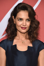 Katie Holmes' red lipstick made a lovely contrast to her navy dress.