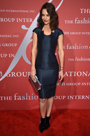 Katie Holmes pulled her look together with a metallic silver clutch by Roger Vivier.
